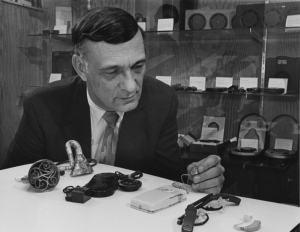 Kenneth W. Berger with hearing aid collection, 1968